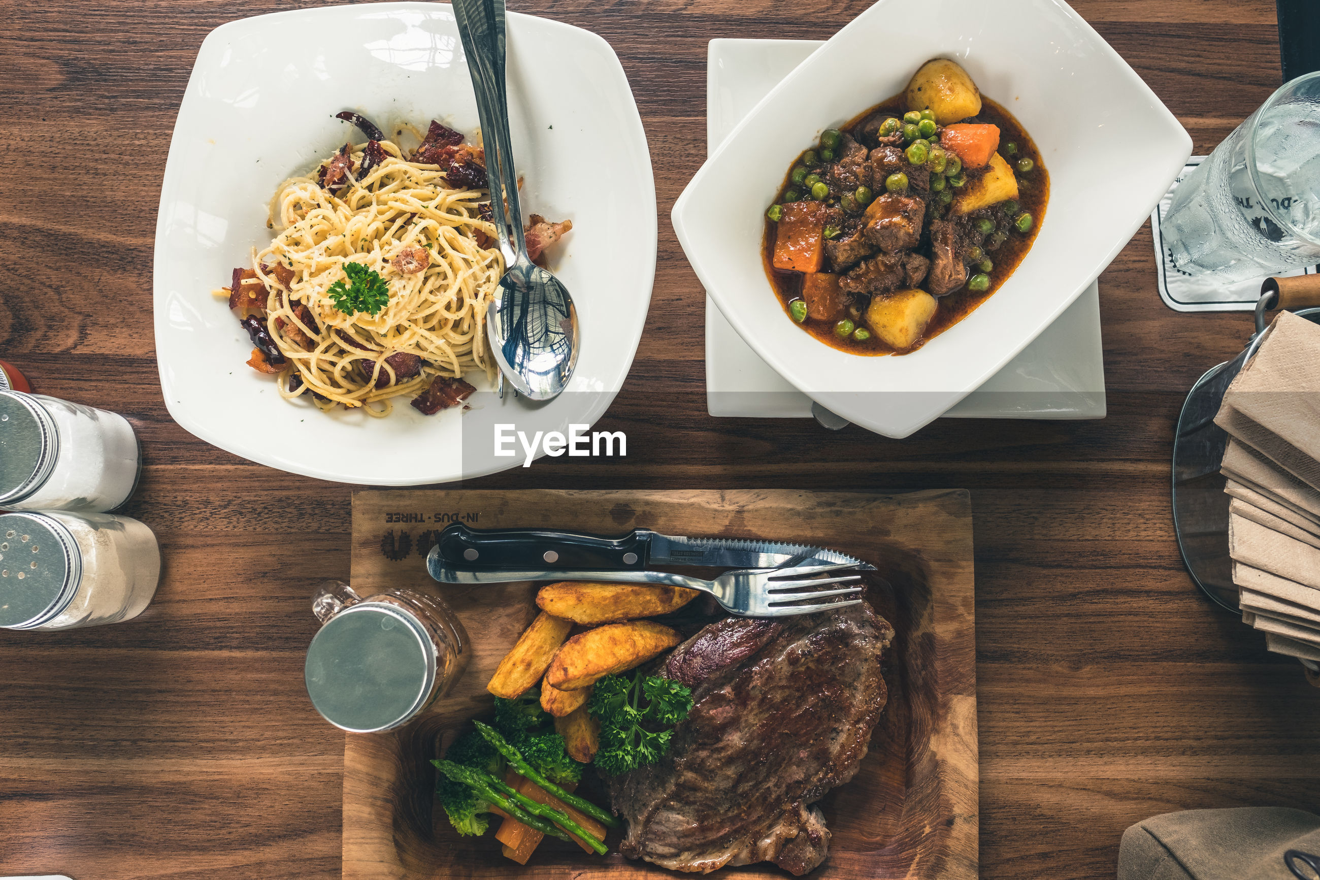 Directly above shot of various food served on wooden table