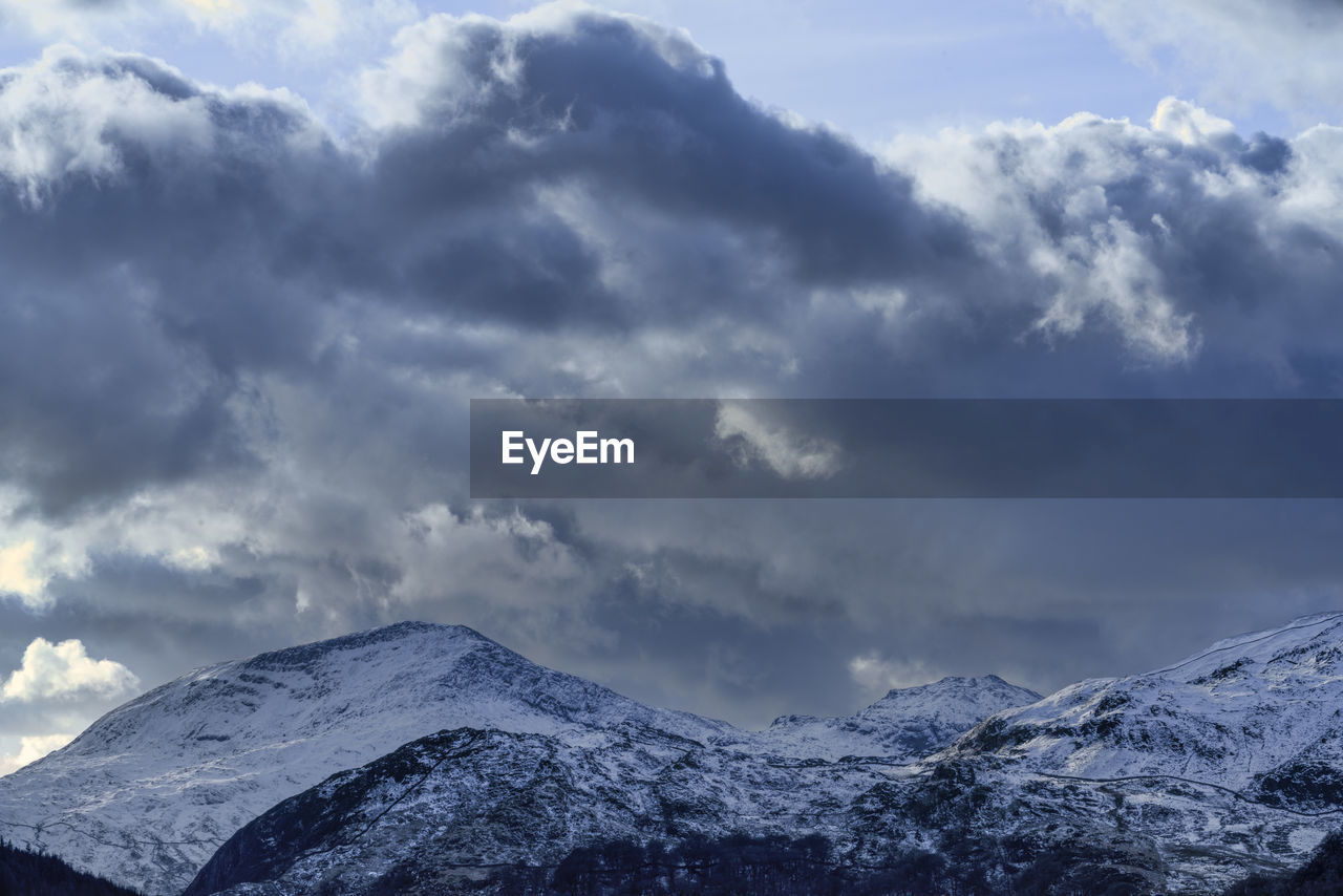 cloud - sky, sky, mountain, scenics - nature, beauty in nature, snow, cold temperature, tranquil scene, tranquility, winter, nature, day, no people, mountain range, snowcapped mountain, non-urban scene, outdoors, low angle view, environment, mountain peak