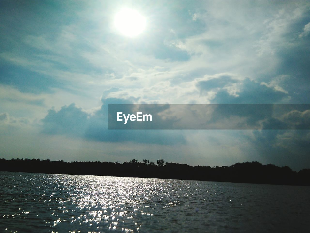 sky, water, nature, tranquility, scenics, beauty in nature, no people, tranquil scene, cloud - sky, outdoors, landscape, lake, scenery, day, tree