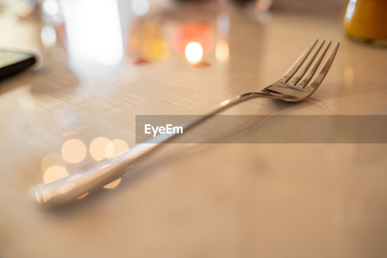 eating utensil, kitchen utensil, fork, selective focus, table, still life, indoors, knife, household equipment, close-up, no people, food and drink, silverware, table knife, food, spoon, metal, plate, butter knife, place setting, setting, crockery, temptation
