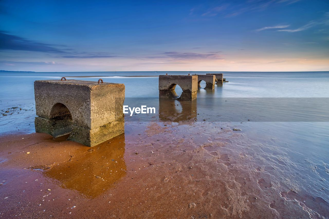 water, sky, sea, horizon over water, horizon, scenics - nature, sunset, beauty in nature, tranquility, tranquil scene, nature, land, beach, idyllic, cloud - sky, no people, non-urban scene, outdoors, solid