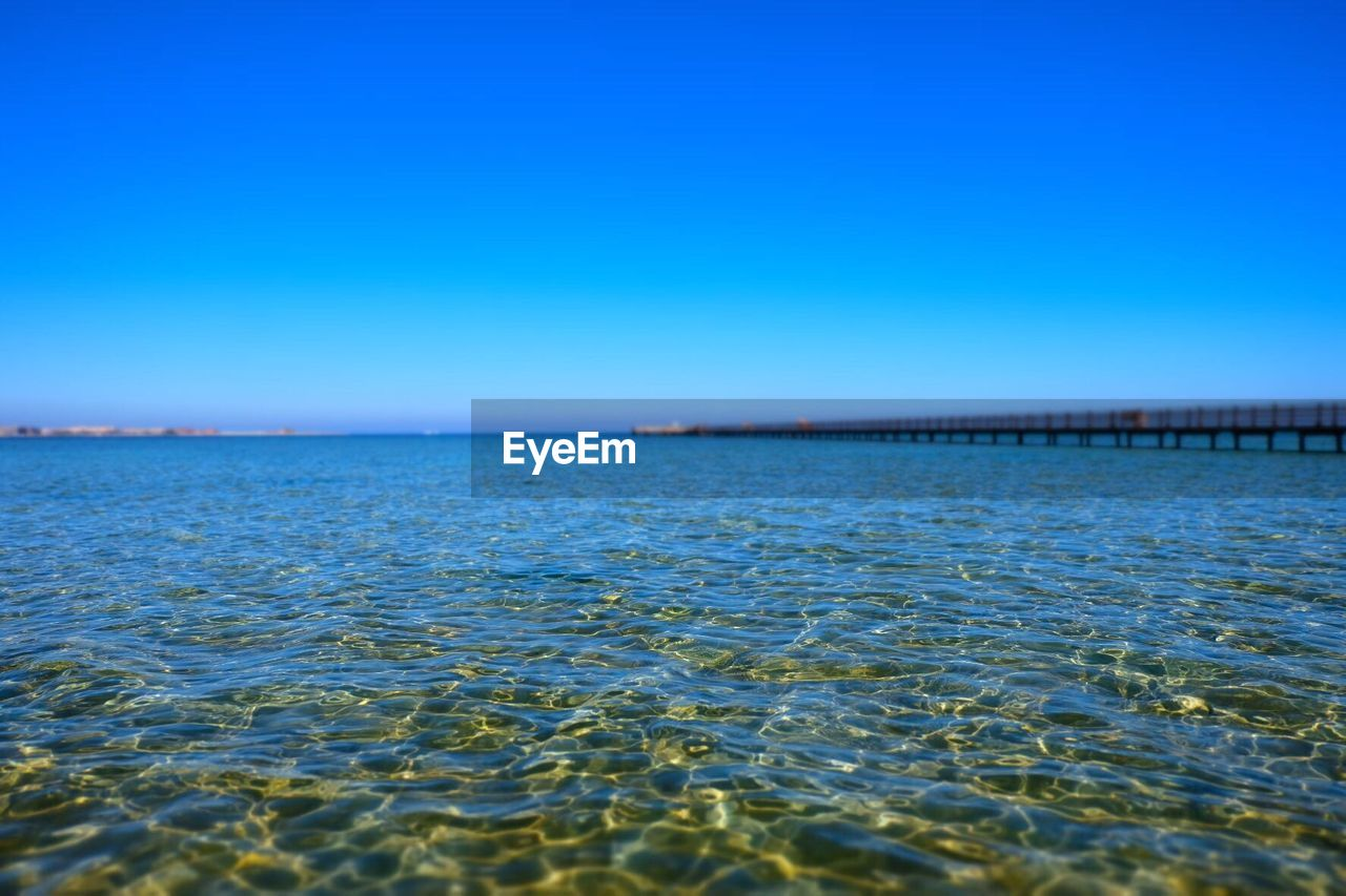 sea, blue, nature, clear sky, tranquility, water, scenics, outdoors, beauty in nature, no people, tranquil scene, rippled, day, sky, summer, beach, horizon over water