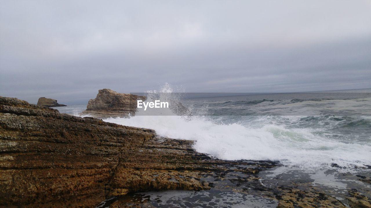 SCENIC VIEW OF Ocean Splashing On Rocks