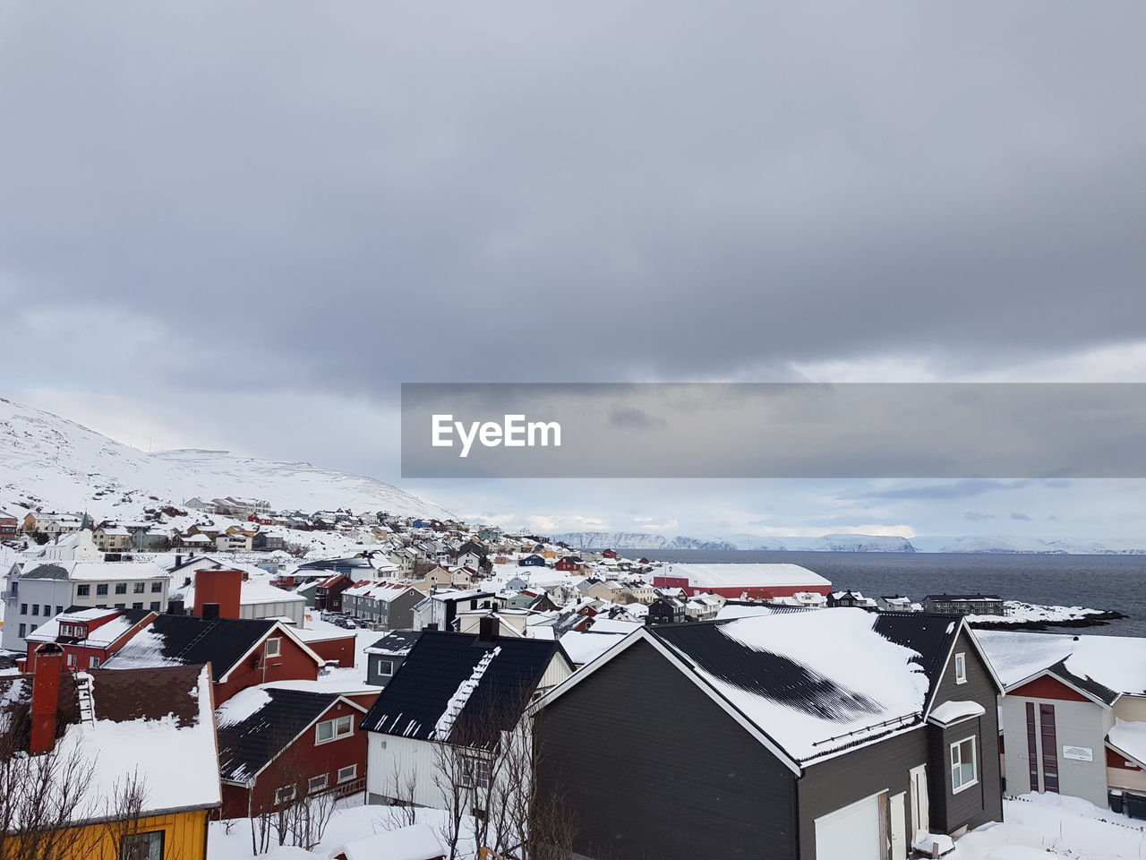 architecture, built structure, building exterior, snow, cloud - sky, building, cold temperature, winter, sky, residential district, house, no people, nature, day, mountain, city, scenics - nature, high angle view, outdoors, snowcapped mountain, townscape
