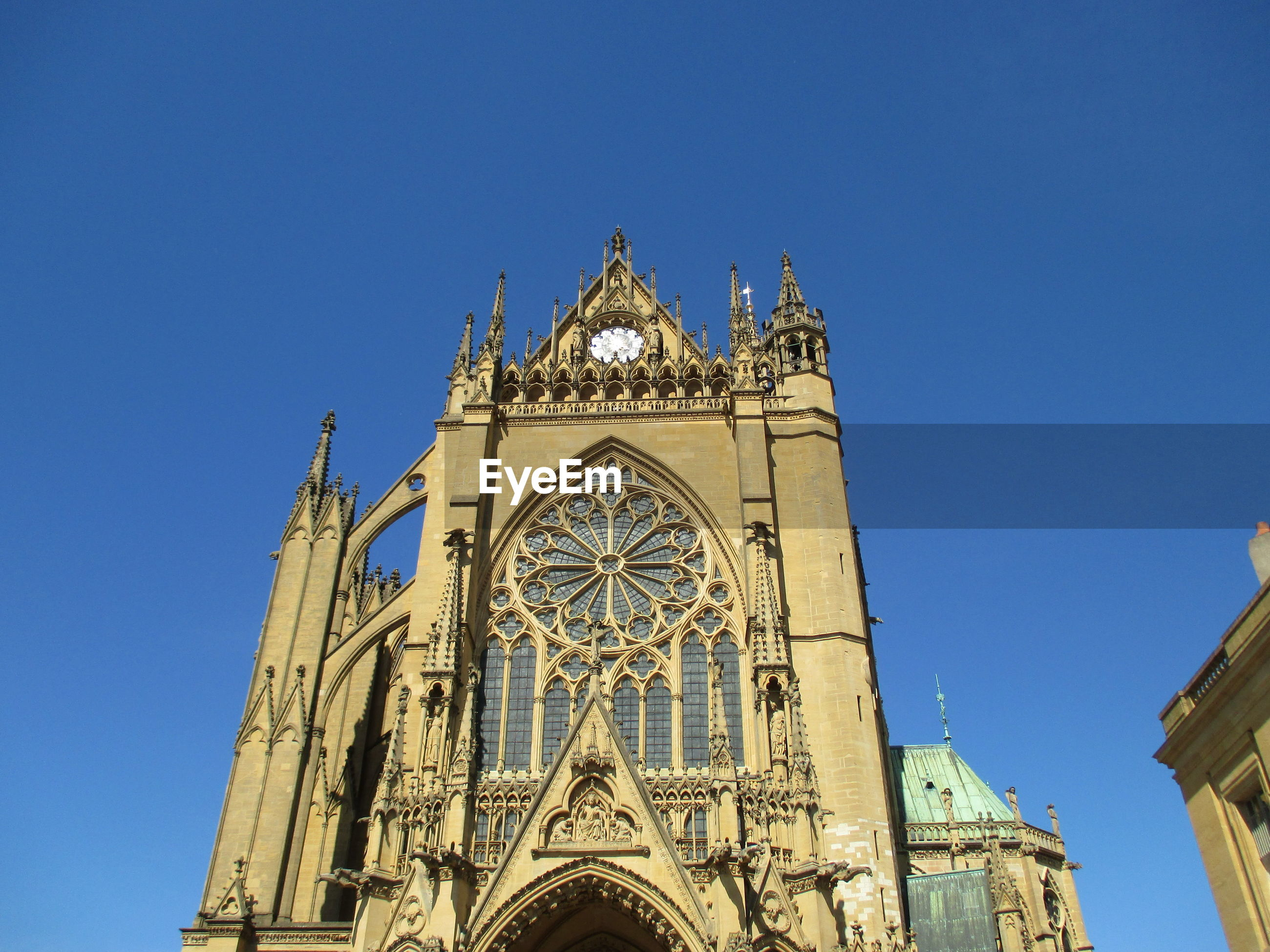 Low angle view of metz cathedral against clear blue sky