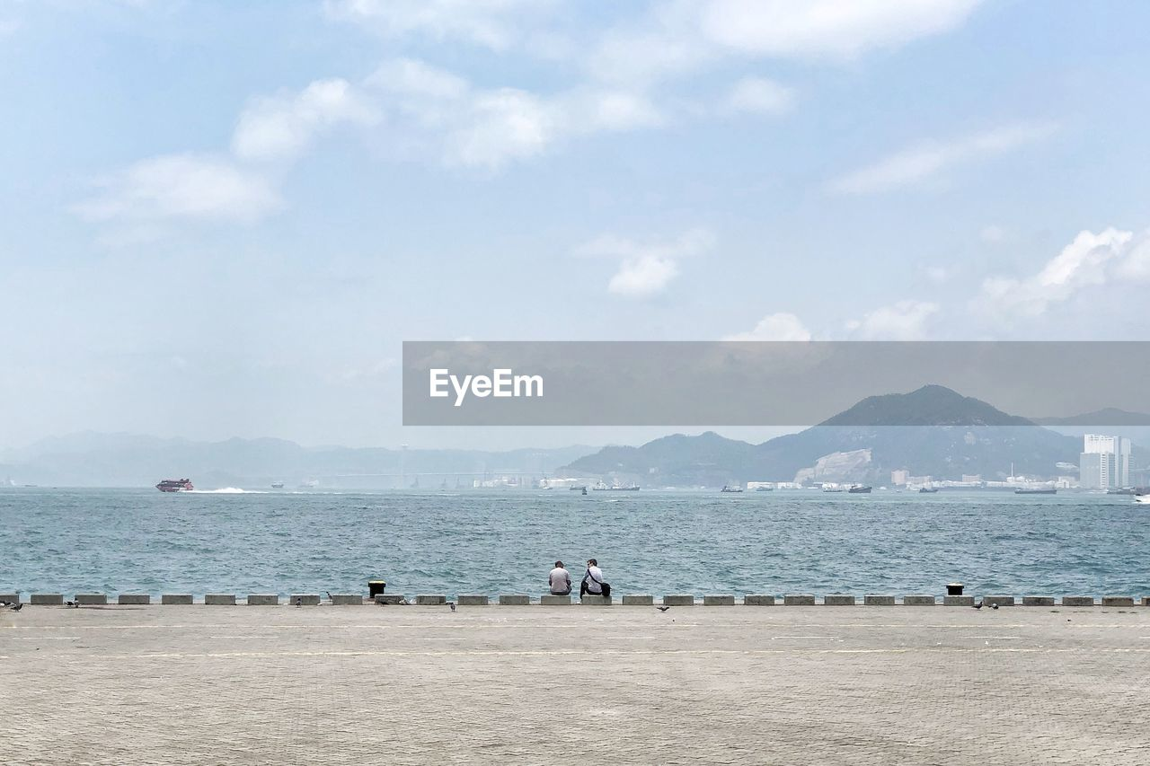 sea, water, sky, cloud - sky, beach, land, scenics - nature, mountain, day, nature, beauty in nature, men, outdoors, tranquil scene, tranquility, non-urban scene, real people, people, idyllic