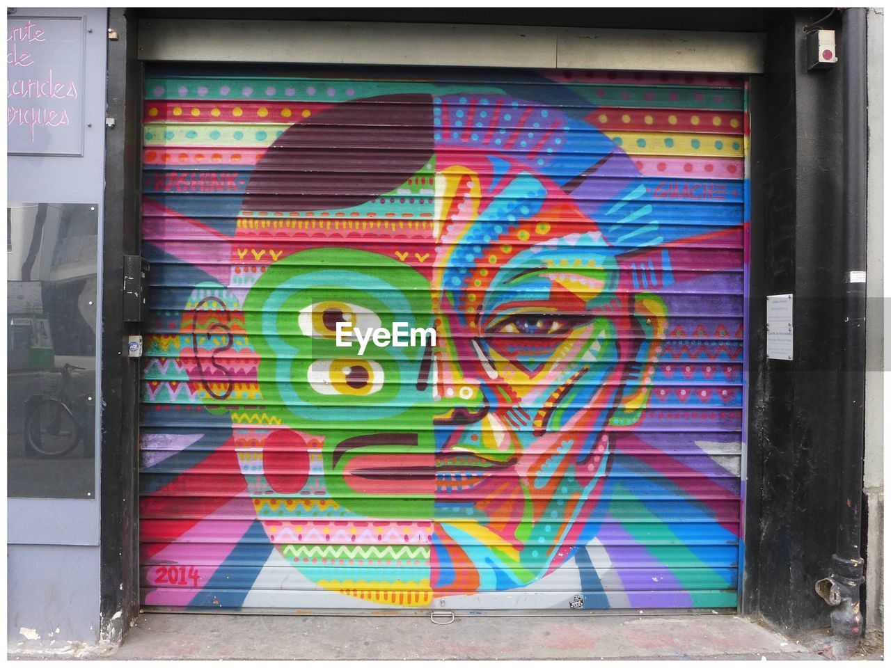 multi colored, graffiti, creativity, no people, art and craft, wall - building feature, architecture, text, communication, built structure, day, western script, close-up, paint, entrance, street art, door, outdoors