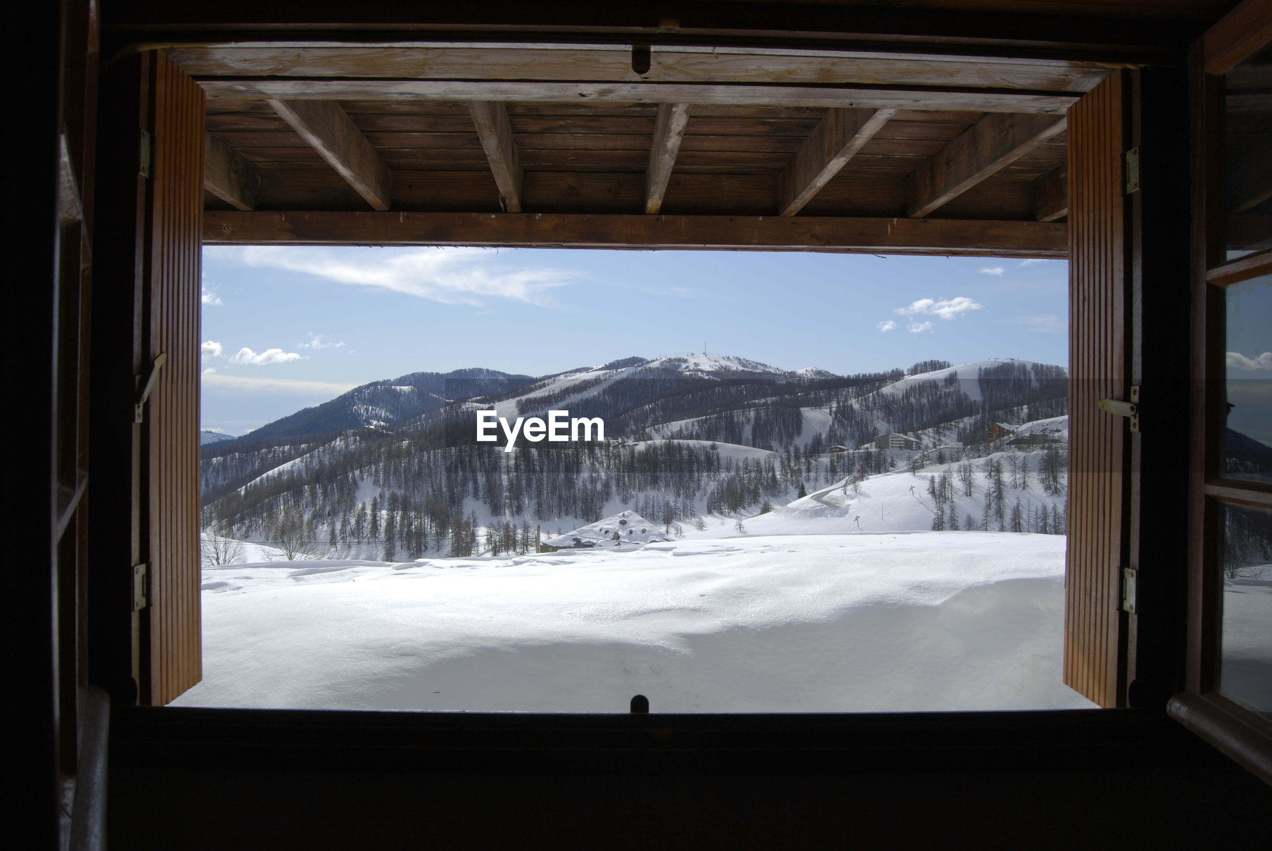 SCENIC VIEW OF SNOWCAPPED MOUNTAINS SEEN FROM WINDOW