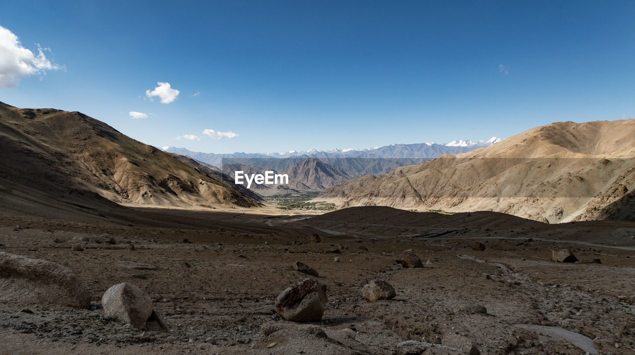 View of mountain range against blue sky