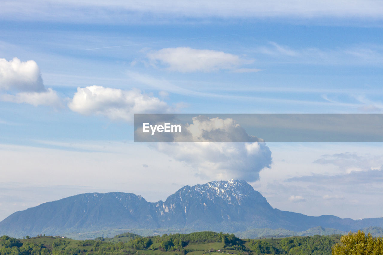 SCENIC VIEW OF MOUNTAIN AGAINST SKY