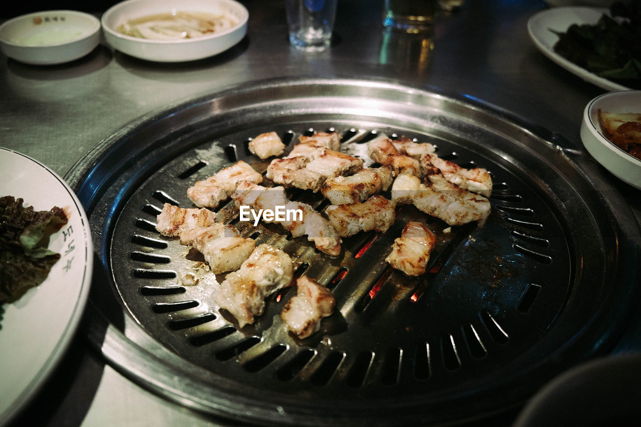 High angle view of meat on barbeque grill