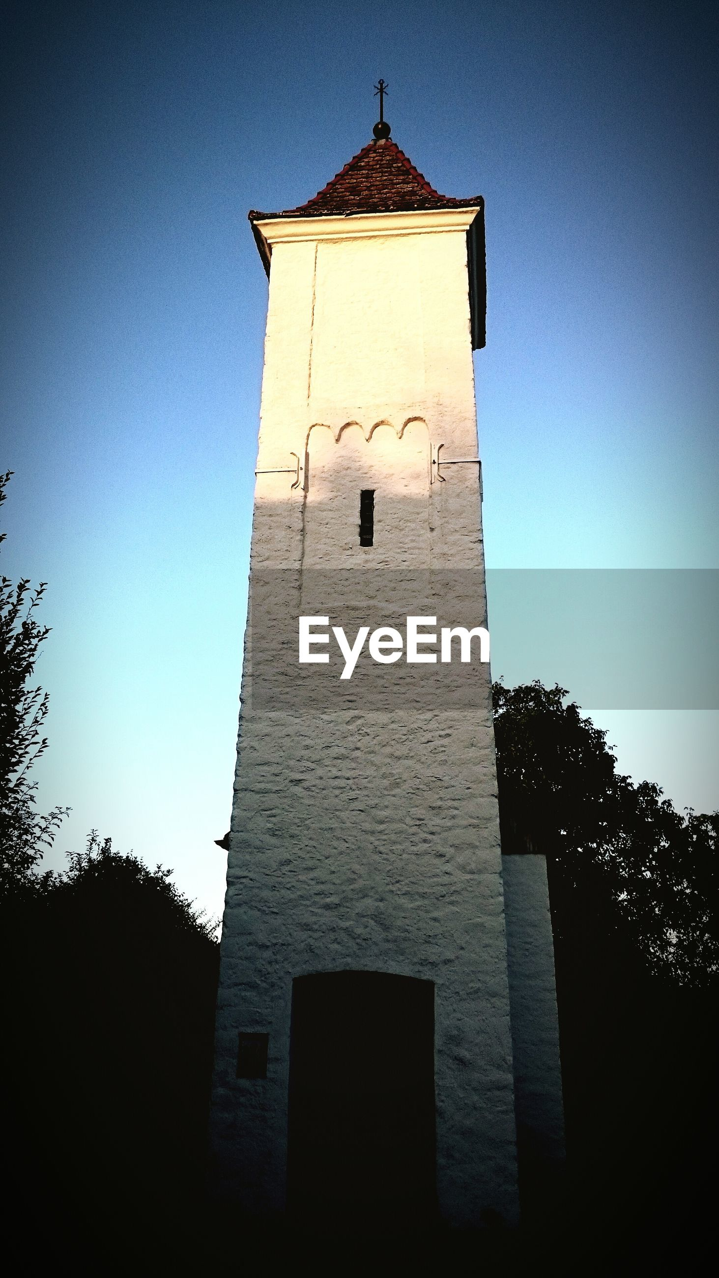 LOW ANGLE VIEW OF CHURCH TOWER AGAINST SKY