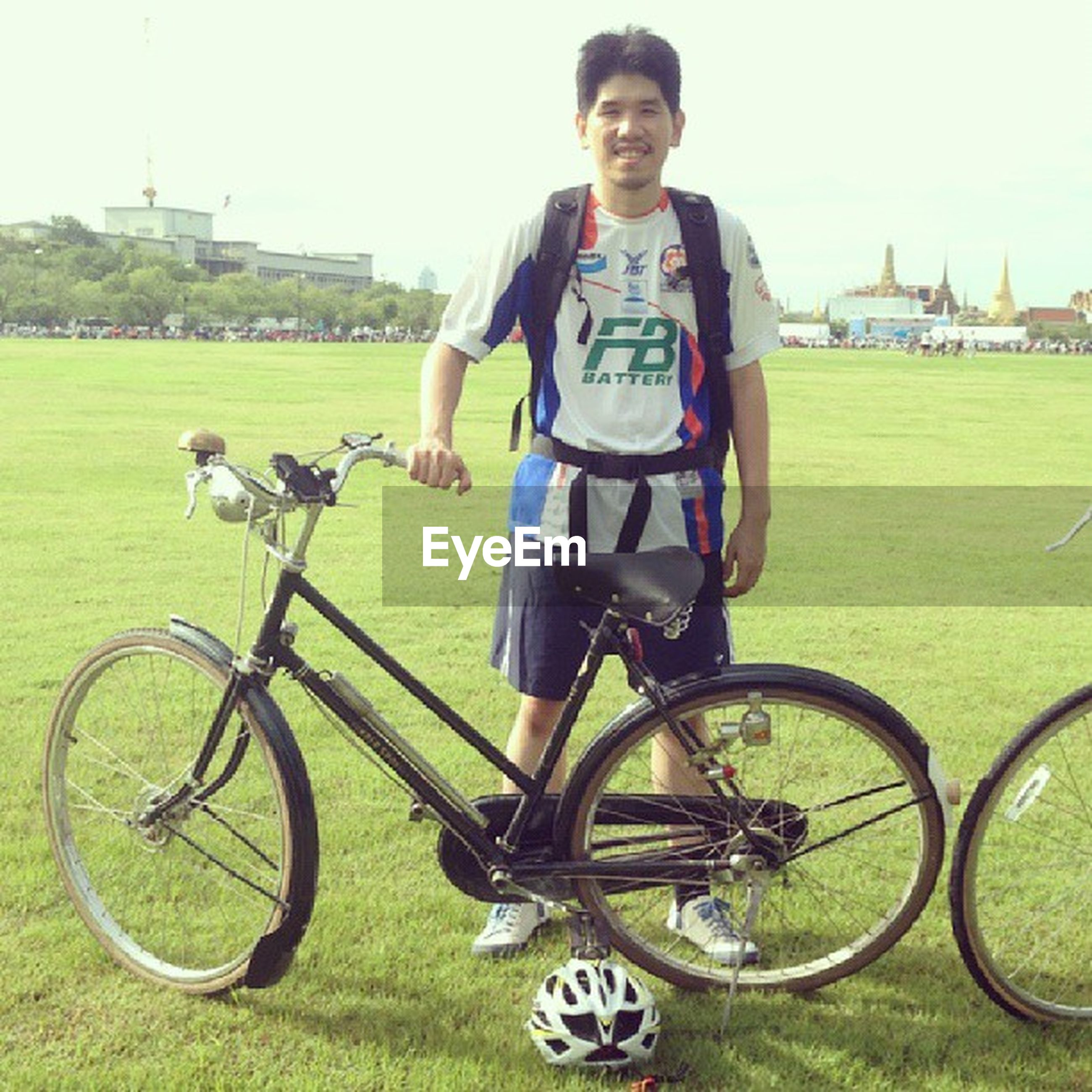 bicycle, grass, person, land vehicle, lifestyles, mode of transport, full length, leisure activity, transportation, casual clothing, looking at camera, portrait, riding, childhood, smiling, young adult, front view, elementary age