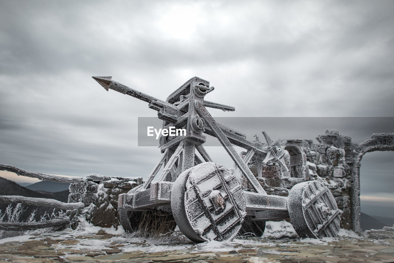 cloud - sky, sky, day, nature, no people, sculpture, art and craft, representation, land, water, outdoors, statue, abandoned, transportation, wood - material, overcast, tranquility, deterioration, creativity, wheel