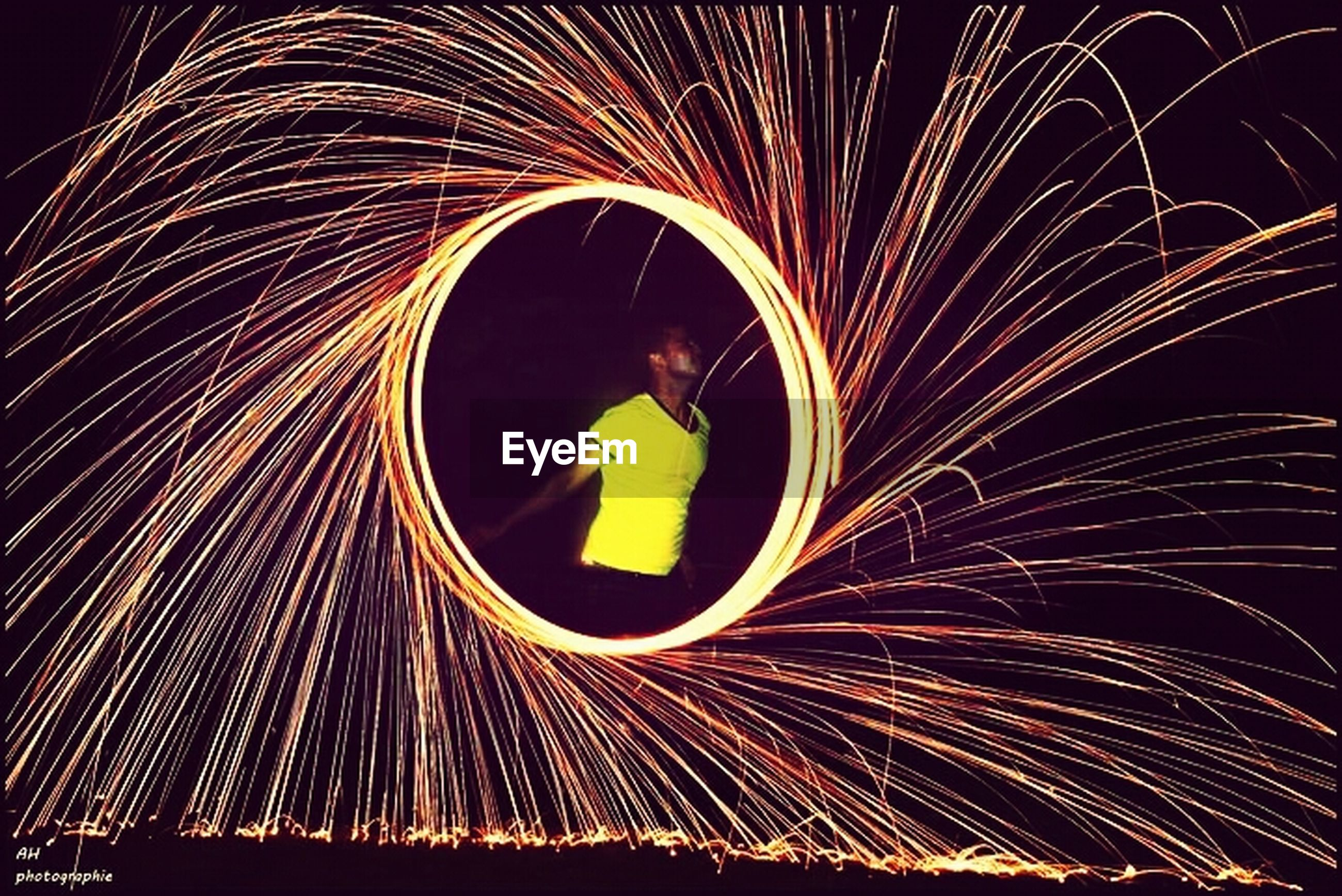 long exposure, night, illuminated, motion, blurred motion, light trail, arts culture and entertainment, circle, glowing, celebration, firework display, pattern, light painting, abstract, sparks, low angle view, multi colored, speed, exploding, spinning