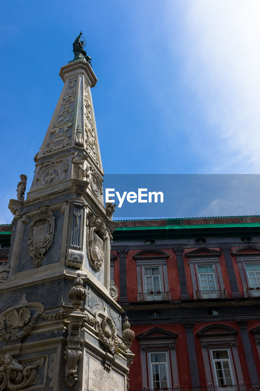architecture, building exterior, low angle view, built structure, outdoors, day, history, sky, religion, no people, blue, statue, city