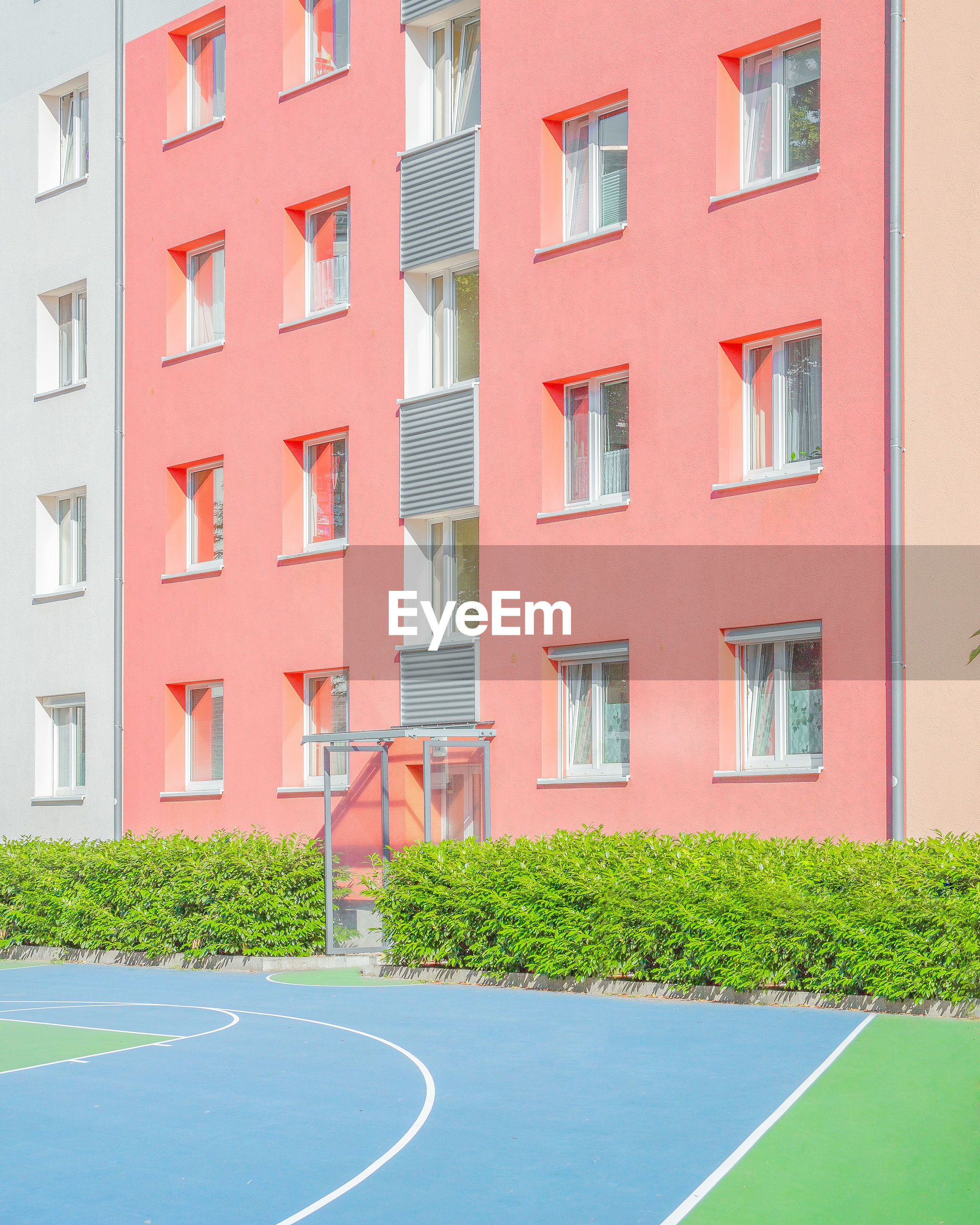 Residential building by sports court