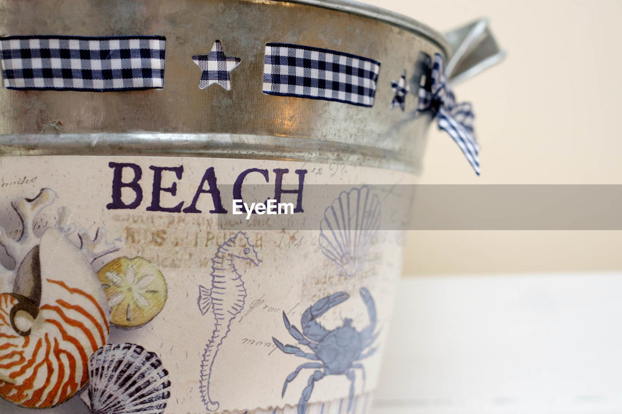 CLOSE-UP OF DRINK IN JAR WITH TEXT
