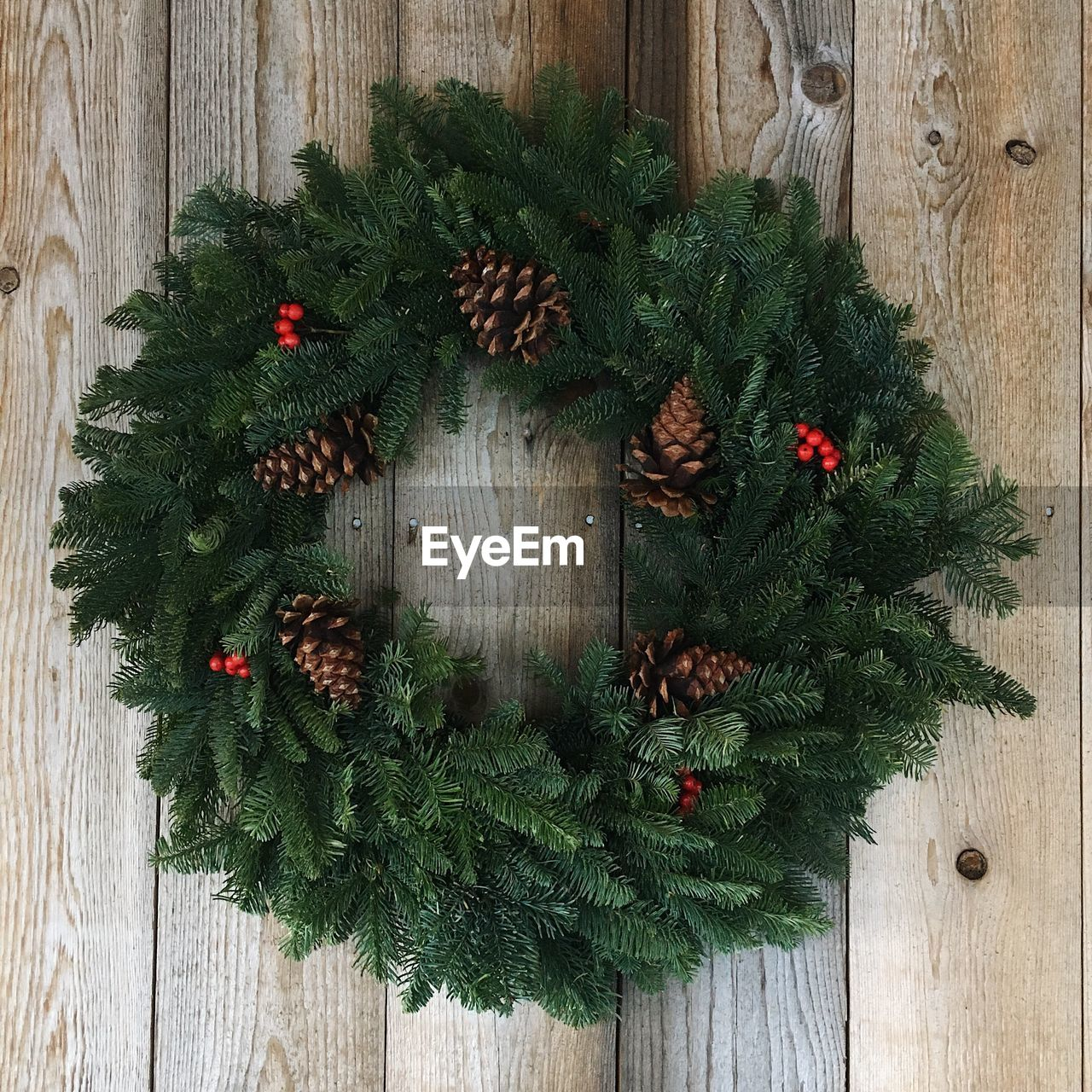 christmas, wood - material, wreath, holiday, decoration, celebration, plant, christmas decoration, christmas tree, no people, green color, directly above, christmas ornament, nature, indoors, tree, pine cone, celebration event, event