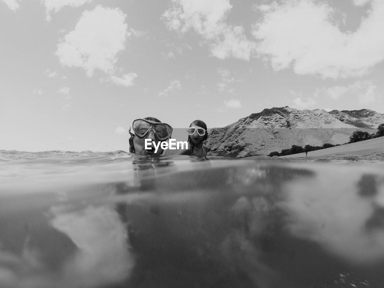 PORTRAIT OF FRIENDS IN WATER