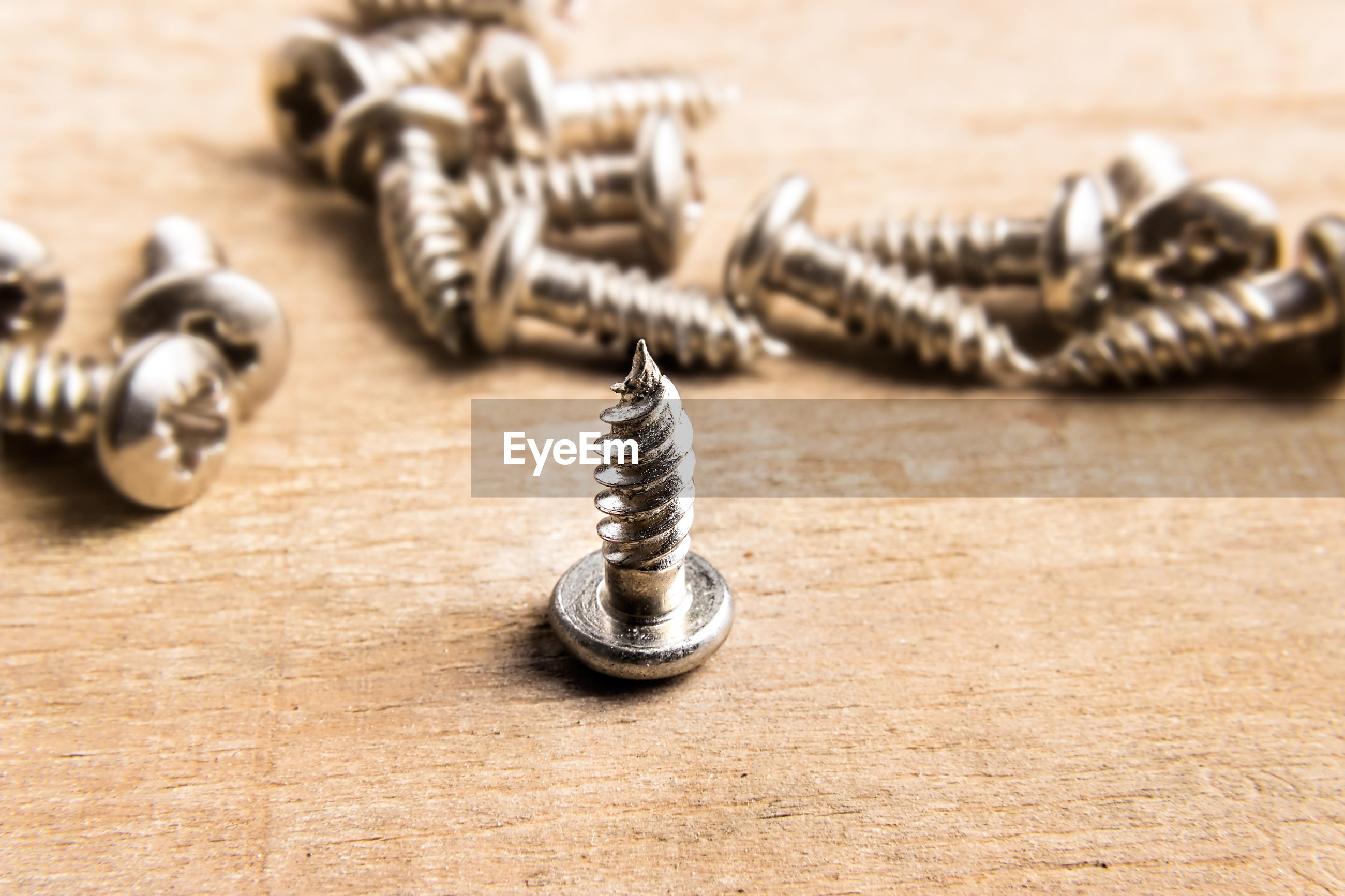 Close-up of screws on table