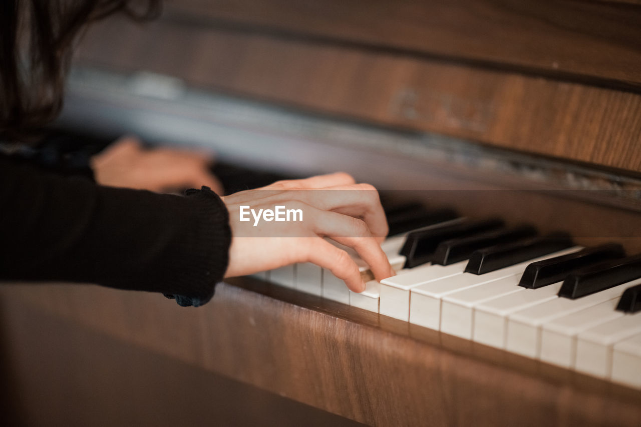 music, musical instrument, musical equipment, human hand, piano, hand, arts culture and entertainment, one person, playing, piano key, indoors, real people, human body part, musician, selective focus, lifestyles, leisure activity, artist, skill, finger, keyboard, human limb, keyboard instrument