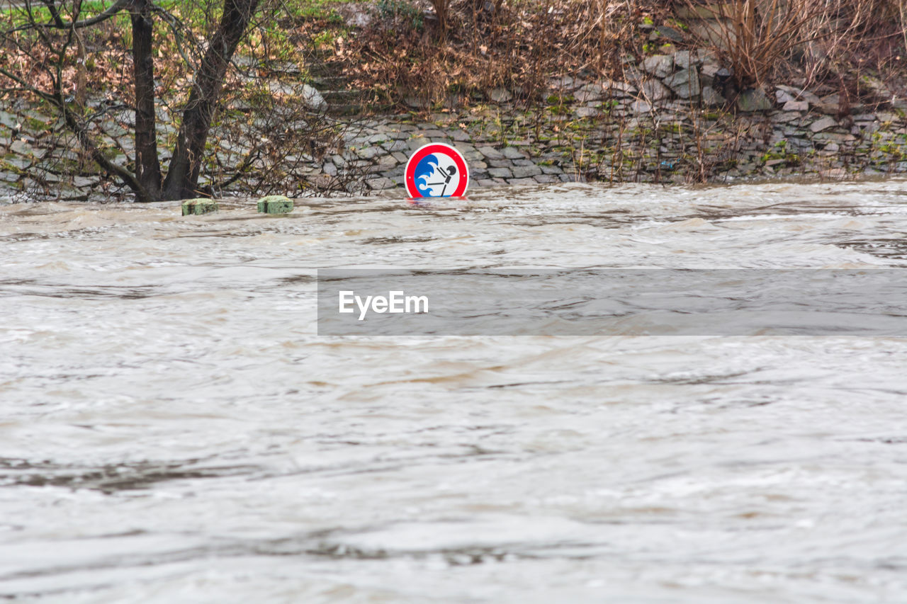 Flood Sign In River During Rainy Season