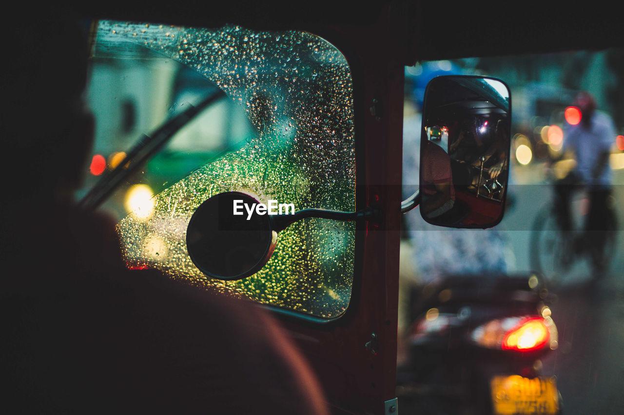 Cropped image of man driving jinrikisha at night