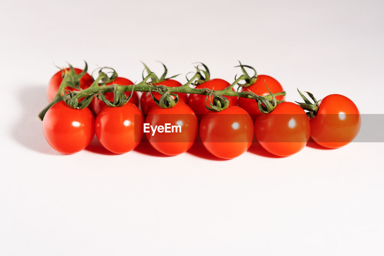tomato, studio shot, red, food, vegetable, white background, freshness, food and drink, wellbeing, fruit, indoors, healthy eating, still life, copy space, cherry tomato, close-up, no people, raw food, cut out, plant stem, ripe, vegetarian food