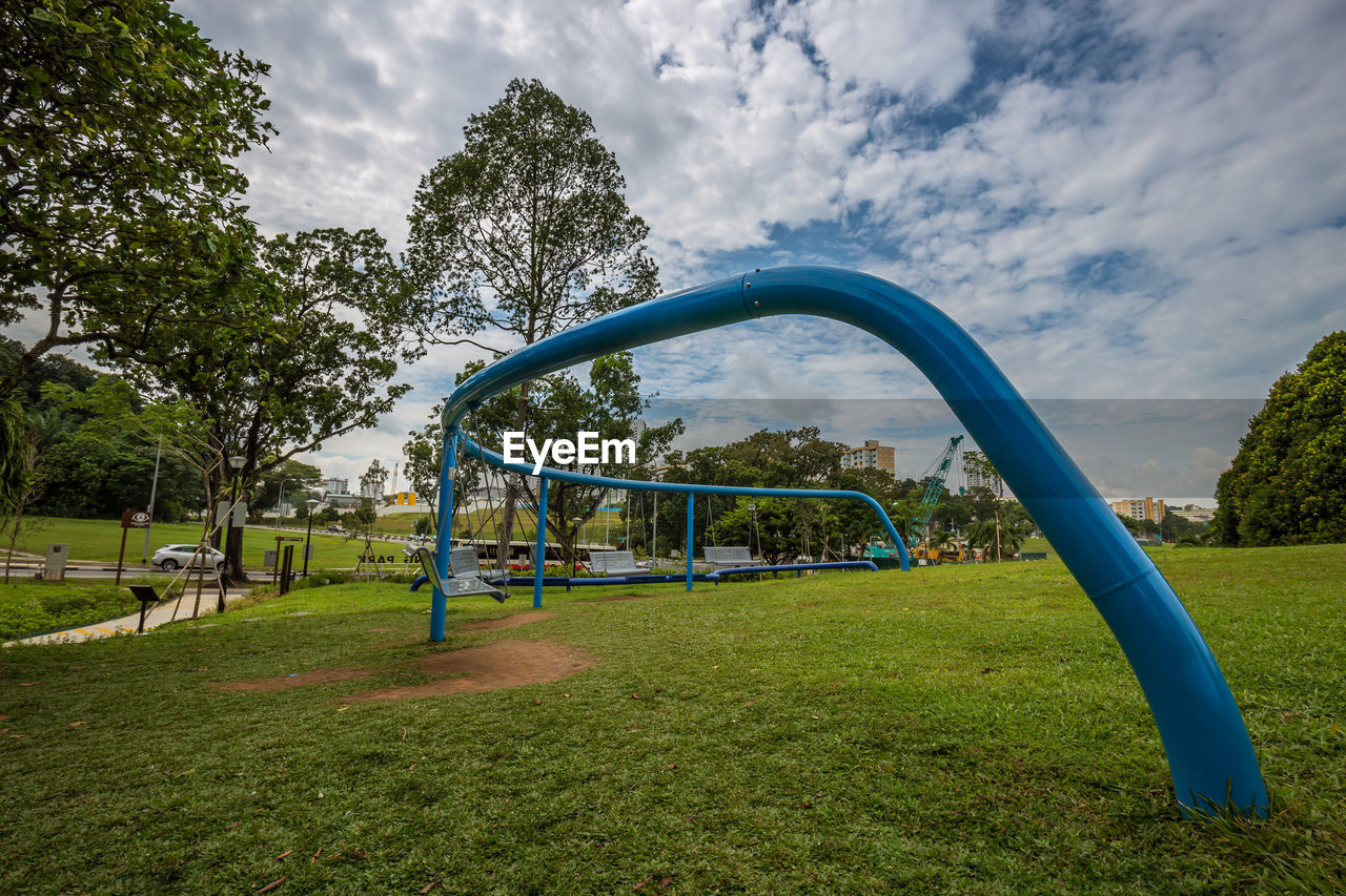 plant, sky, tree, cloud - sky, grass, nature, day, playground, green color, blue, park, outdoor play equipment, childhood, park - man made space, outdoors, land, absence, growth, field
