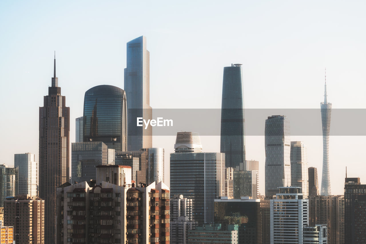 Skyscrapers In City Against Clear Sky