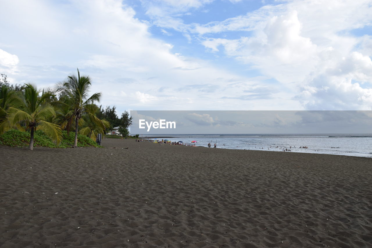 sky, beach, land, cloud - sky, sea, sand, water, beauty in nature, scenics - nature, tranquility, tropical climate, tree, palm tree, tranquil scene, horizon, horizon over water, nature, plant, non-urban scene, outdoors, no people