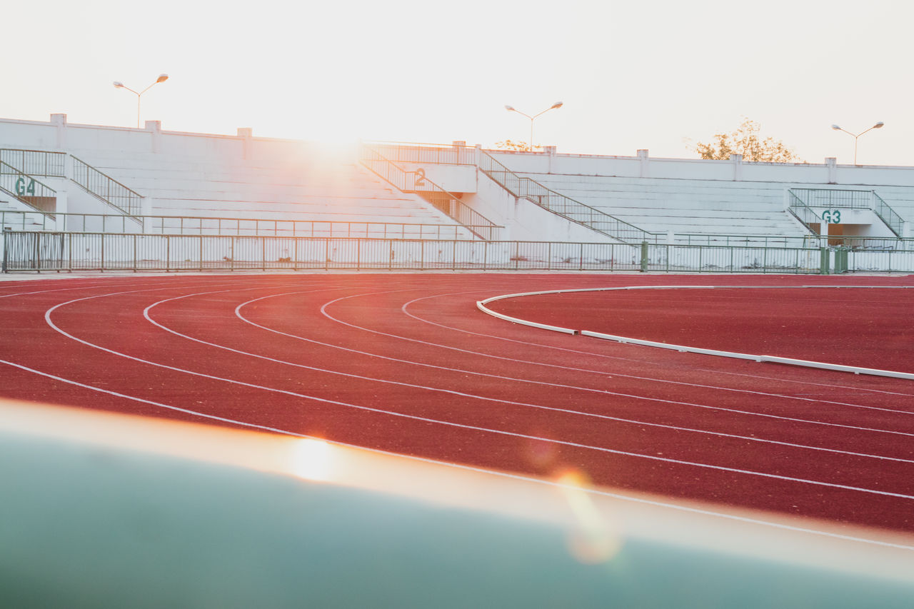 sport, track and field, running track, sky, sports track, no people, nature, stadium, absence, red, outdoors, sunset, exercising, day, empty, curve, architecture, lens flare, sunlight, competition