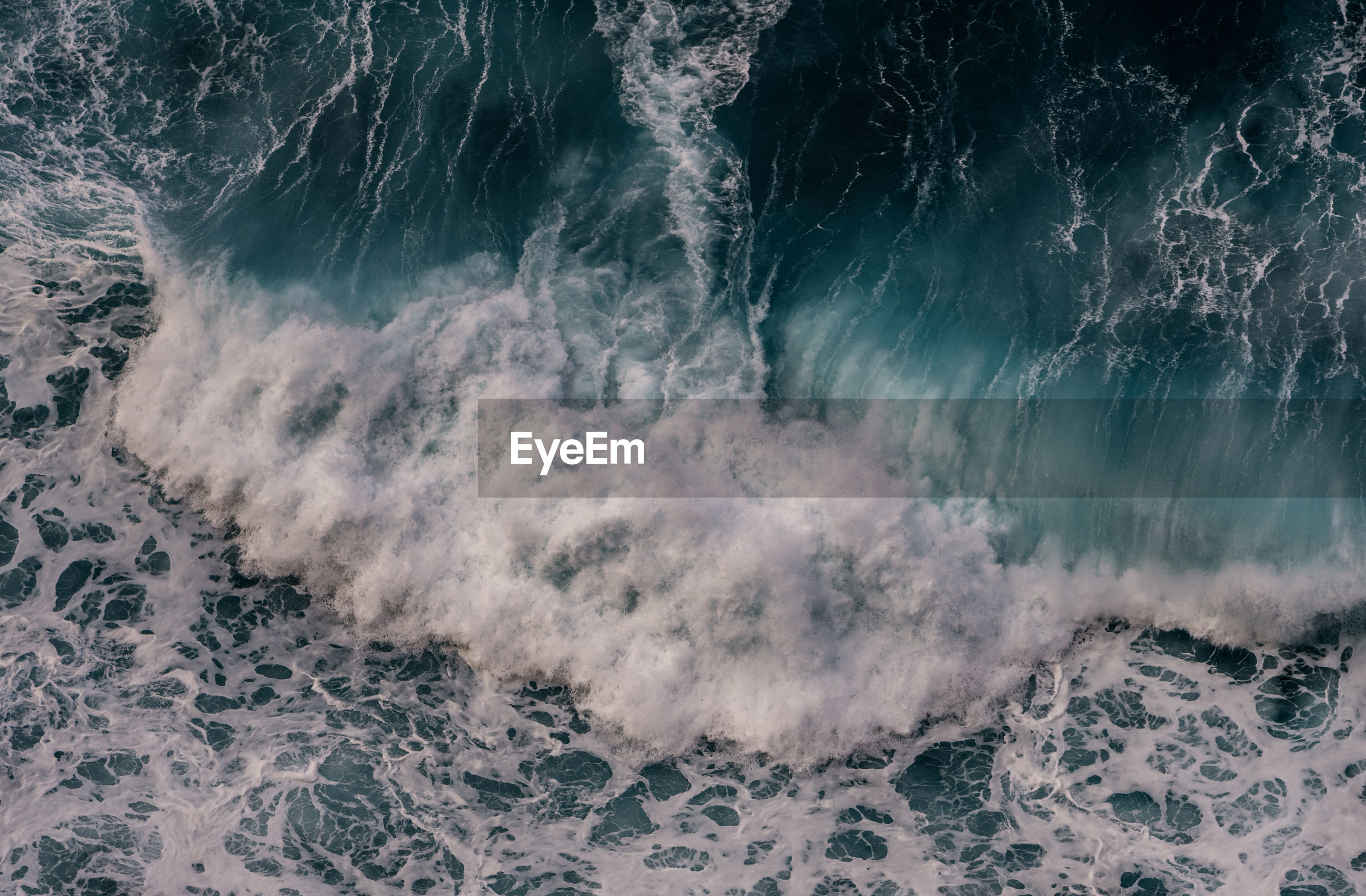 High angle view of waves breaking on sea shore