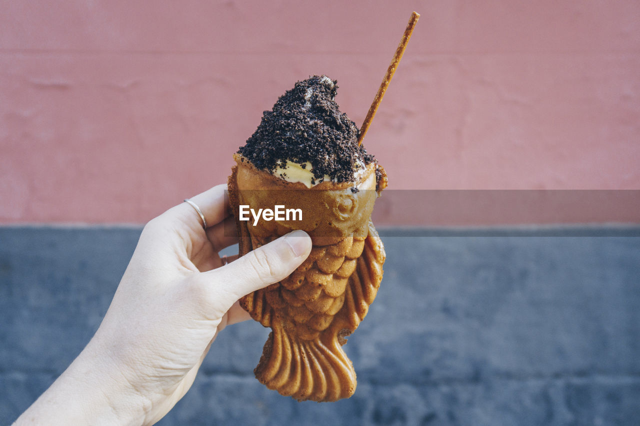 Cropped hand holding ice cream