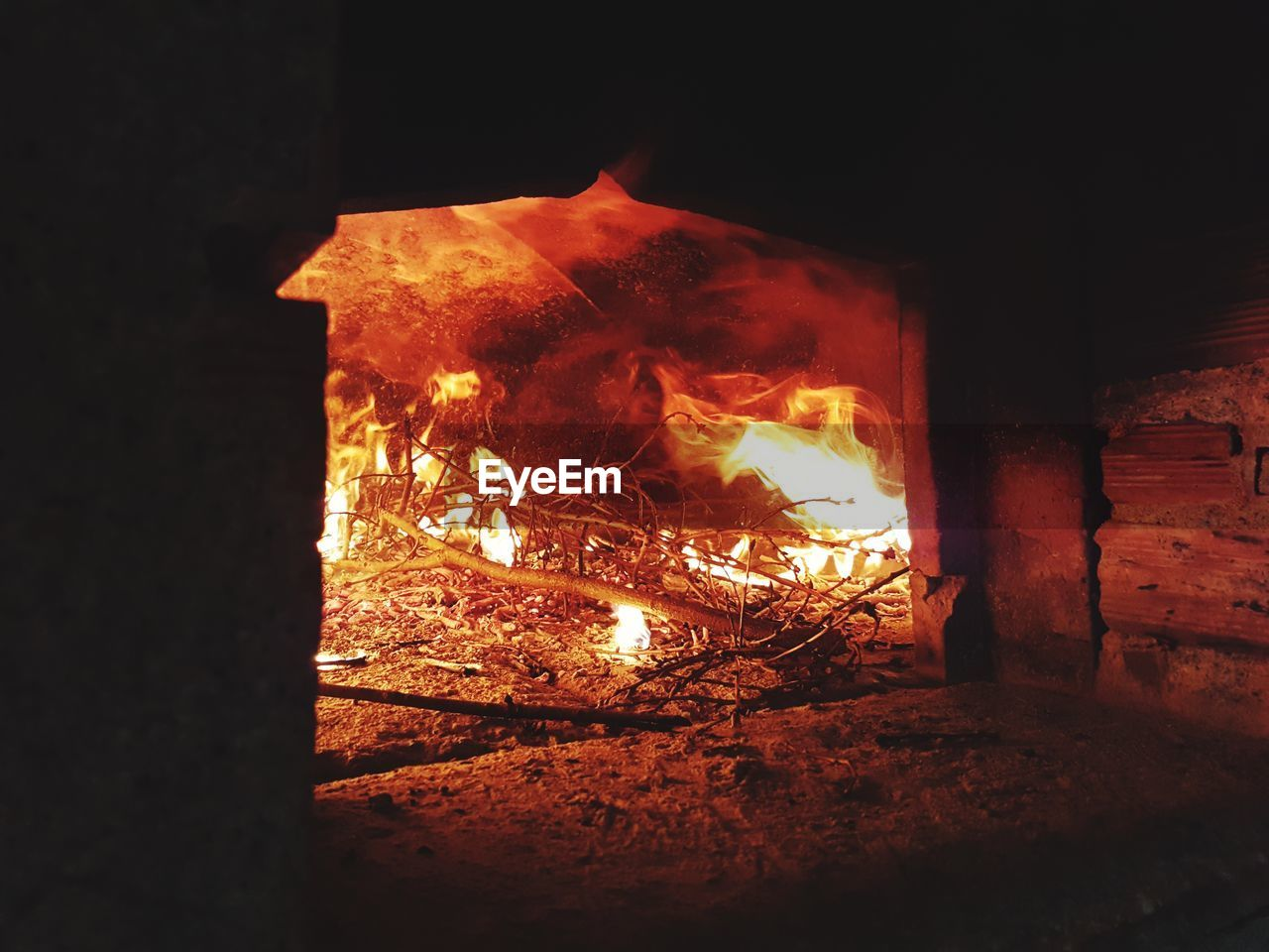 burning, fire, heat - temperature, flame, fire - natural phenomenon, wood, log, wood - material, fireplace, glowing, night, firewood, nature, no people, indoors, motion, orange color, brick, architecture