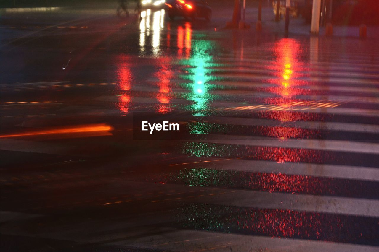 High angle view of wet illuminated pedestrian crossing
