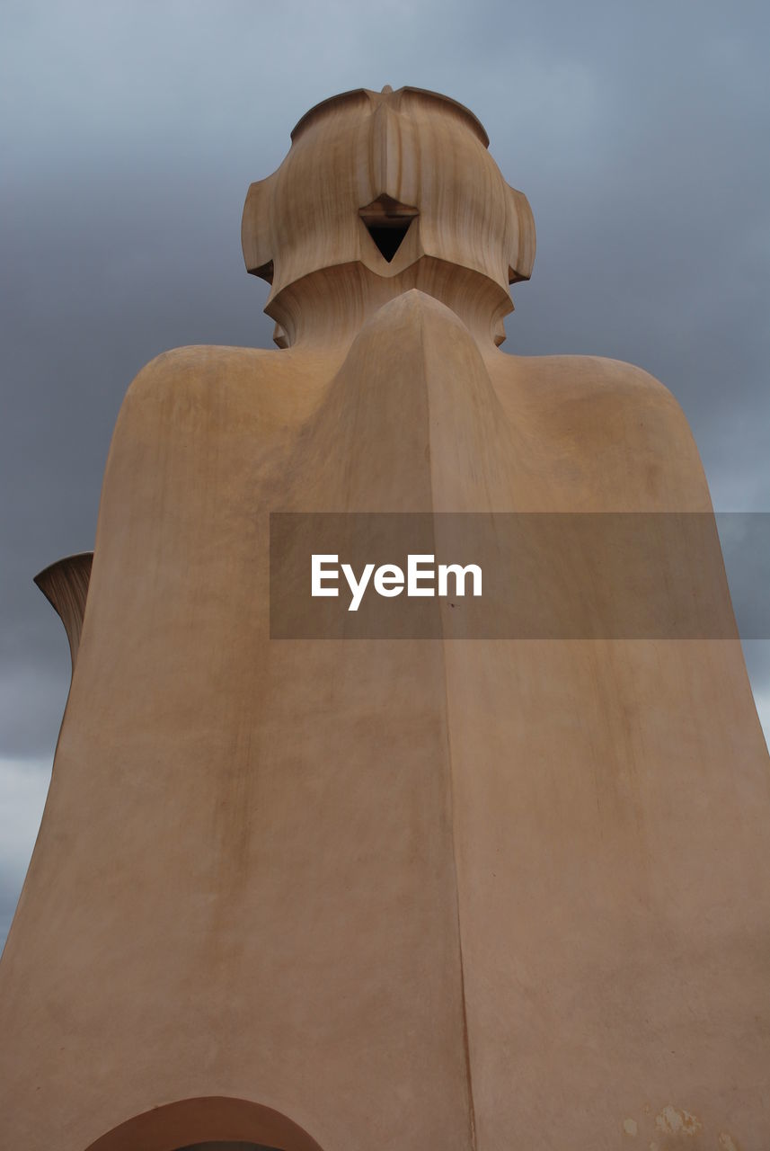 human representation, statue, sculpture, art and craft, male likeness, craft, low angle view, no people, sky, day, outdoors, built structure, gold colored, architecture, close-up