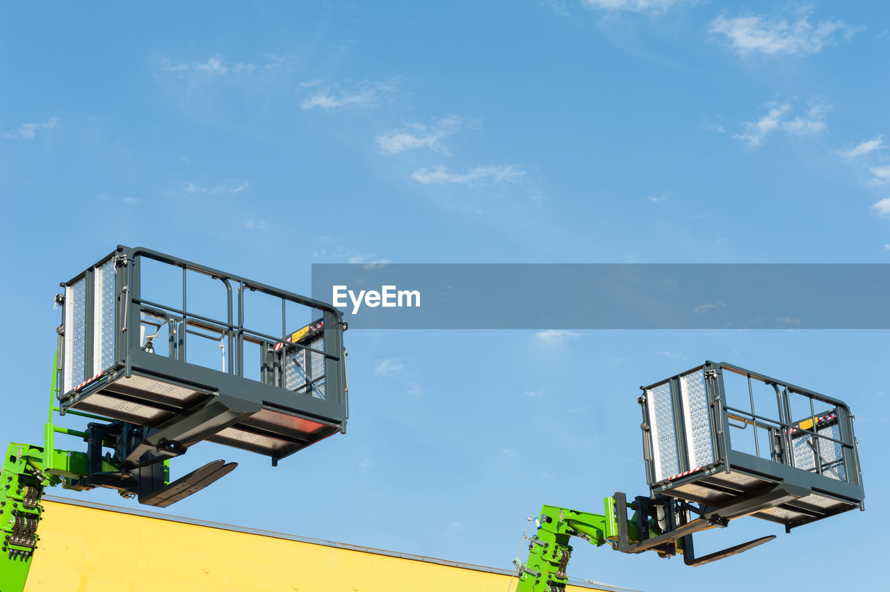 sky, low angle view, nature, machinery, day, industry, cloud - sky, no people, blue, outdoors, architecture, sunlight, technology, built structure, sign, metal, crane - construction machinery, equipment, communication, control, industrial equipment