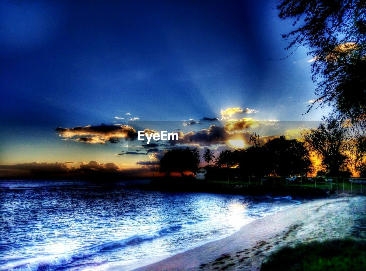 sky, beauty in nature, nature, scenics, sunset, tree, cloud - sky, tranquil scene, no people, water, silhouette, tranquility, outdoors, motion, sea, blue, wave, day