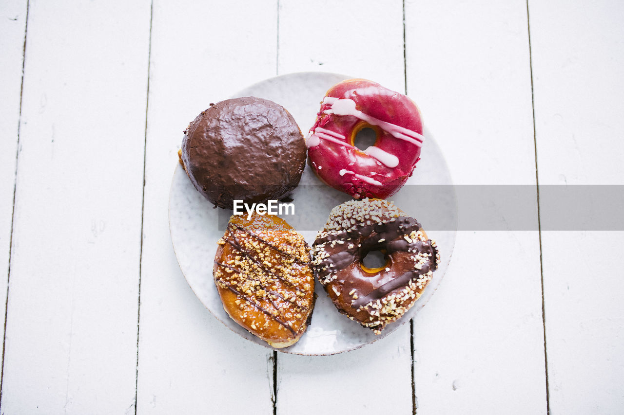 food and drink, food, still life, freshness, ready-to-eat, table, sweet food, indulgence, indoors, high angle view, directly above, baked, donut, unhealthy eating, no people, sweet, temptation, close-up, dessert, snack