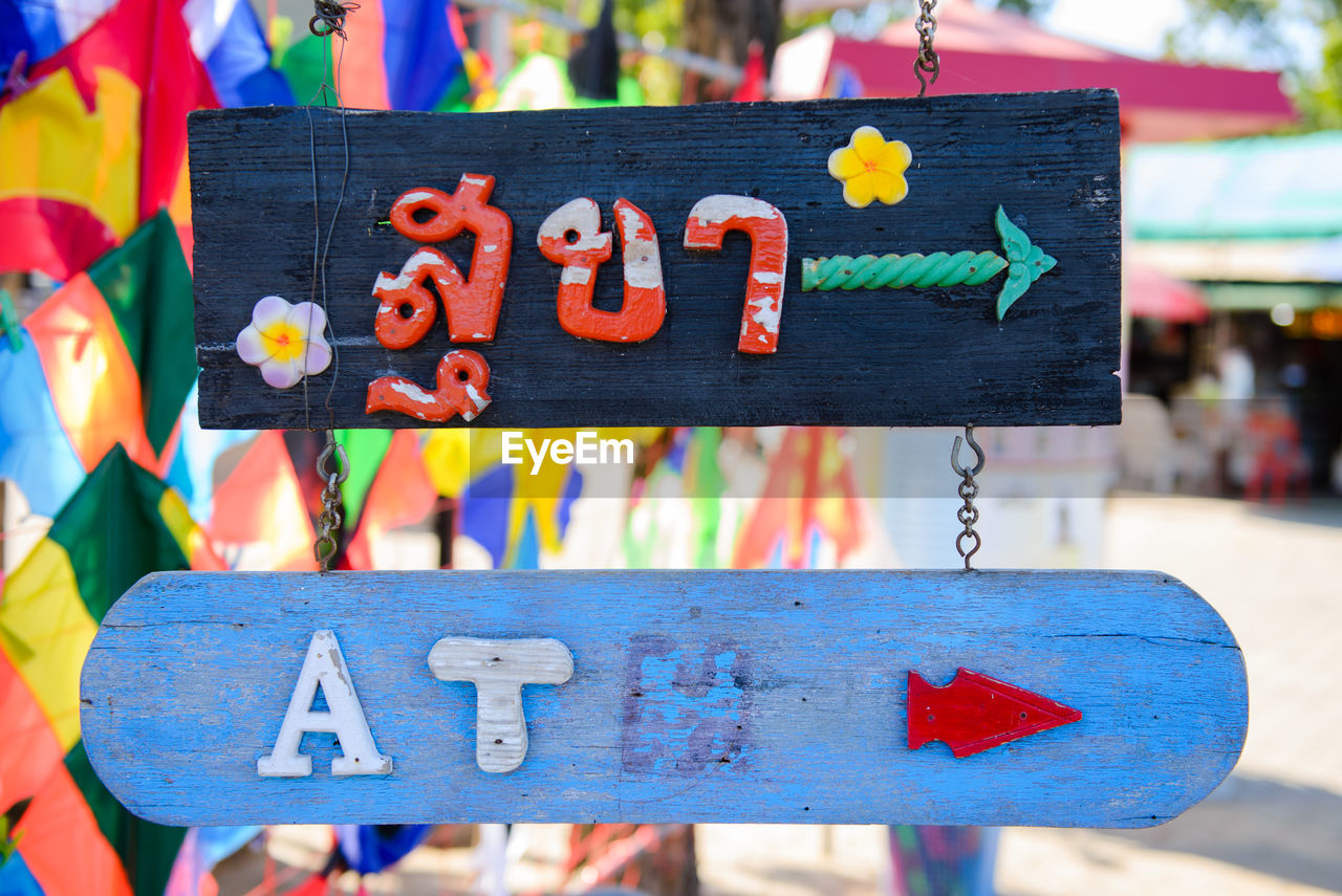 Close-Up Of Colorful Sign