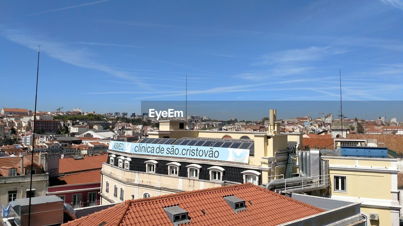 architecture, building exterior, built structure, roof, sky, day, antenna - aerial, no people, outdoors, high angle view, house, blue, residential building, television aerial, town, cityscape, city, tiled roof