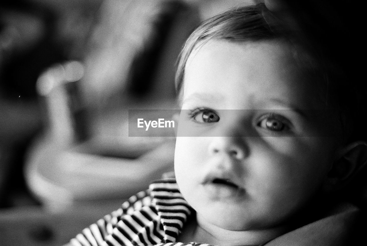 child, childhood, portrait, one person, headshot, innocence, real people, focus on foreground, looking at camera, close-up, indoors, cute, leisure activity, lifestyles, boys, girls, males, human face