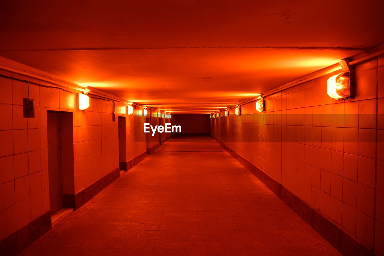 illuminated, architecture, lighting equipment, the way forward, diminishing perspective, built structure, direction, indoors, no people, arcade, corridor, building, wall - building feature, ceiling, flooring, empty, light, footpath, electric light, tile, underground walkway, electricity, tiled floor, underpass