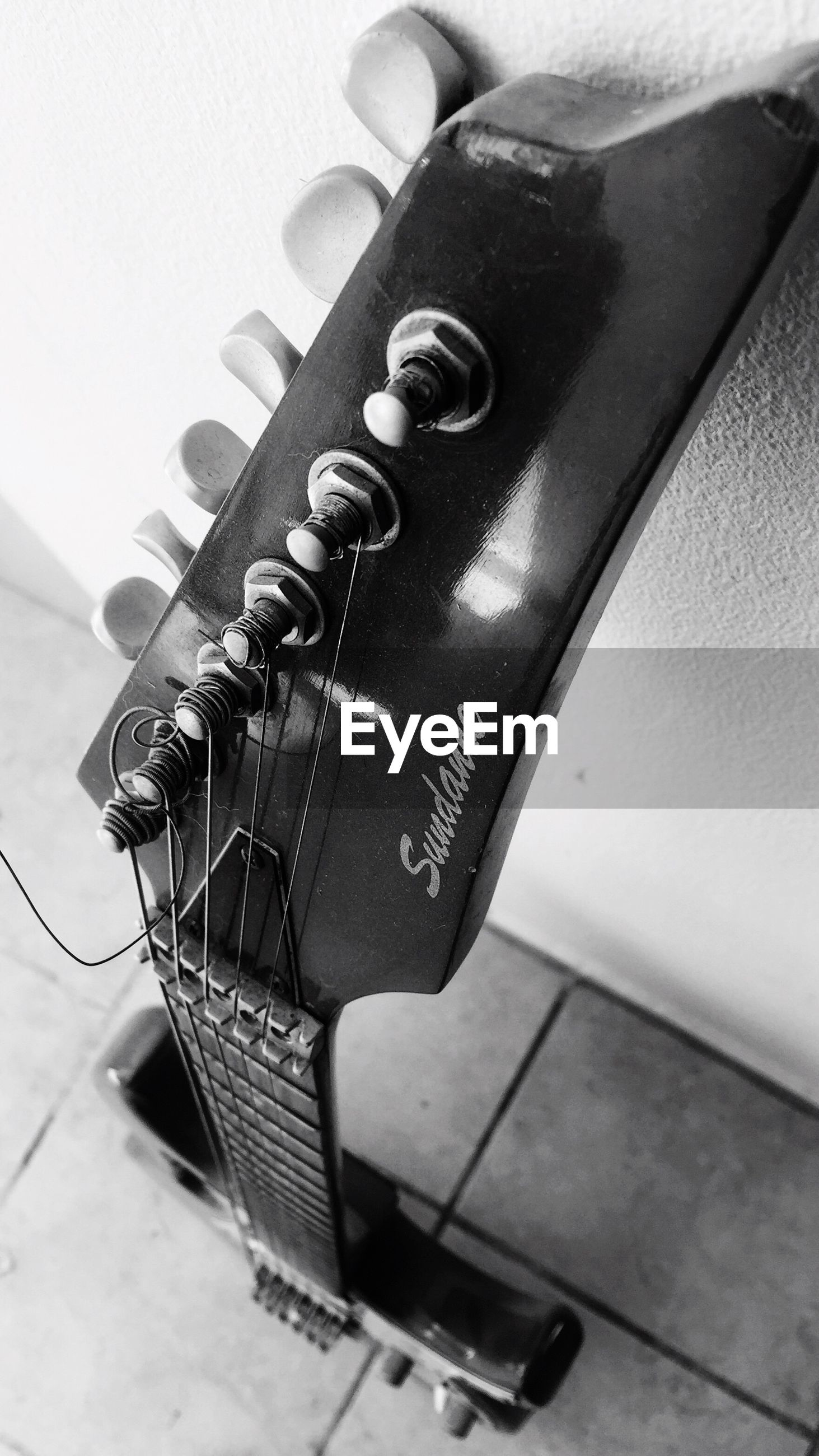 music, indoors, close-up, no people, musical instrument, guitar, musical instrument string, day