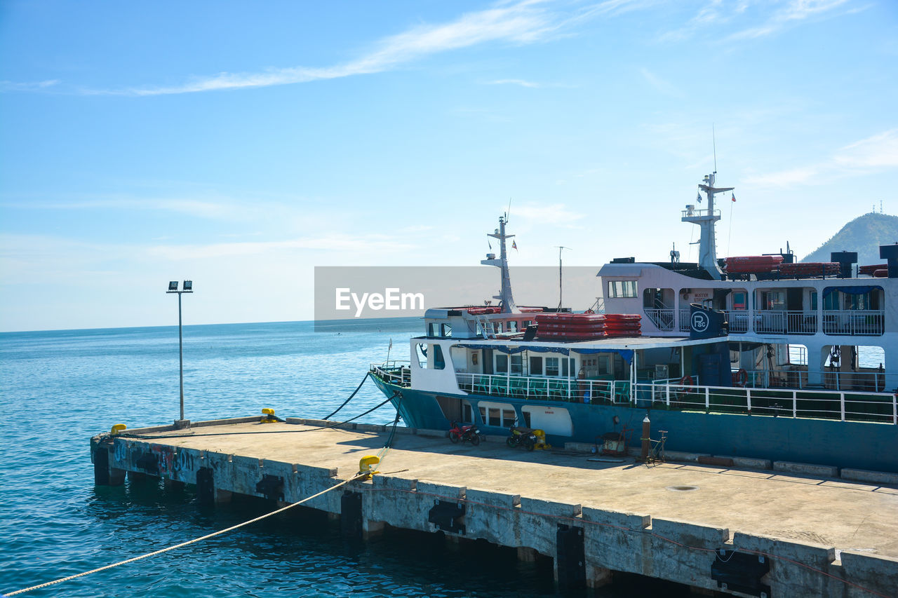 sky, water, sea, nautical vessel, transportation, cloud - sky, nature, mode of transportation, architecture, built structure, no people, day, building exterior, ship, outdoors, pier, horizon over water, horizon, moored, passenger craft