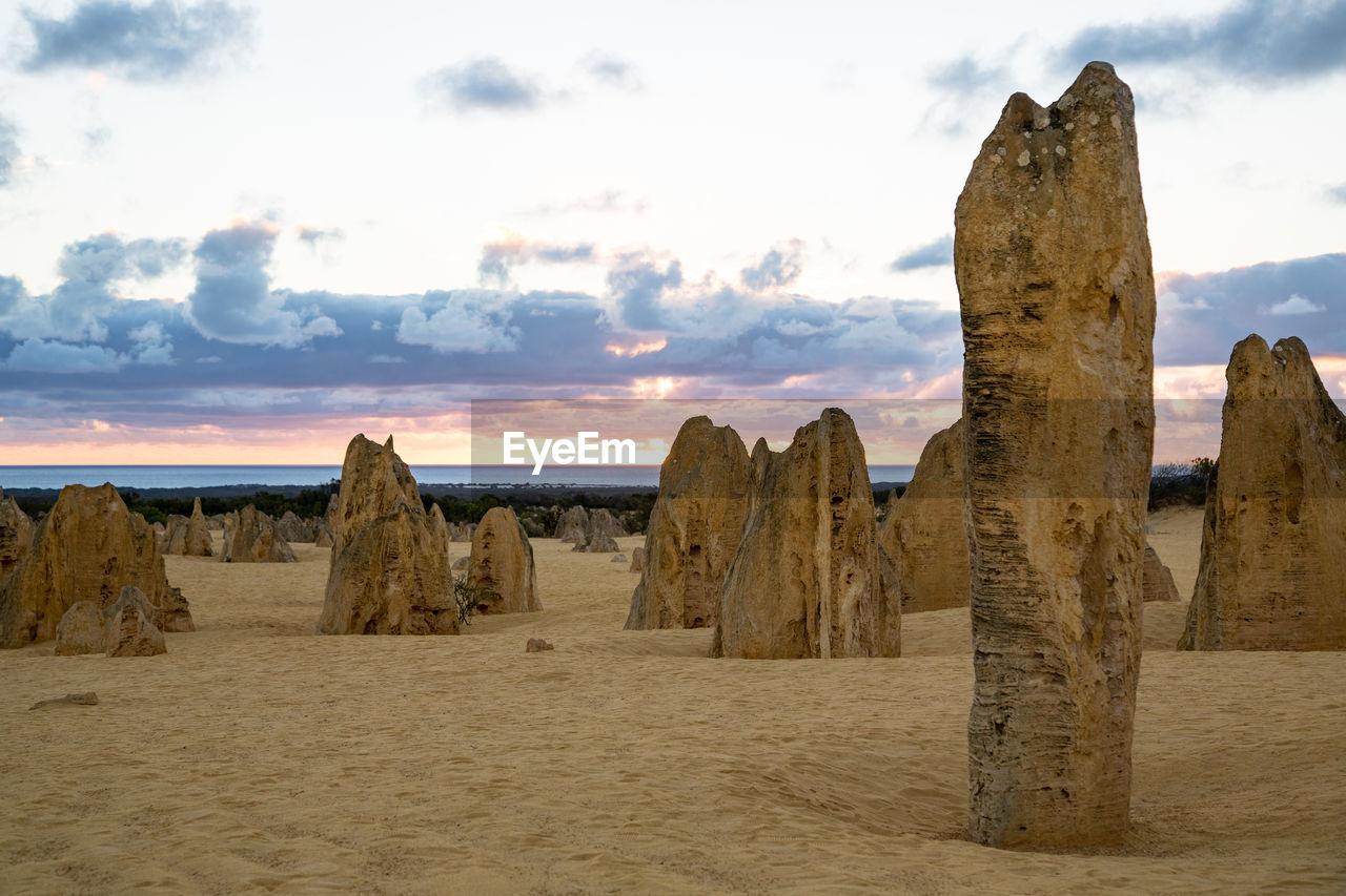 Old ruin at beach against sky