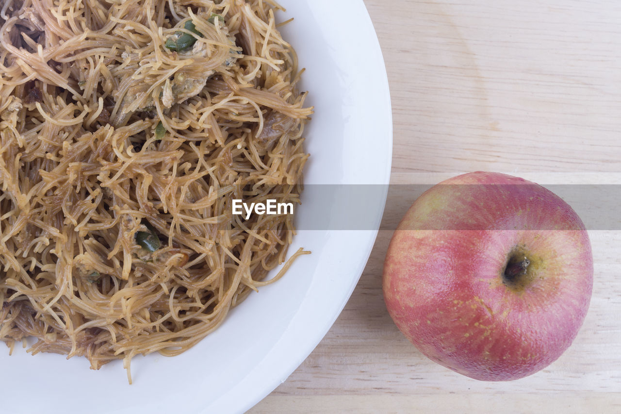 food and drink, food, wellbeing, healthy eating, table, freshness, still life, fruit, high angle view, no people, indoors, close-up, apple - fruit, directly above, wood - material, plate, pasta, italian food, red, ready-to-eat, ripe