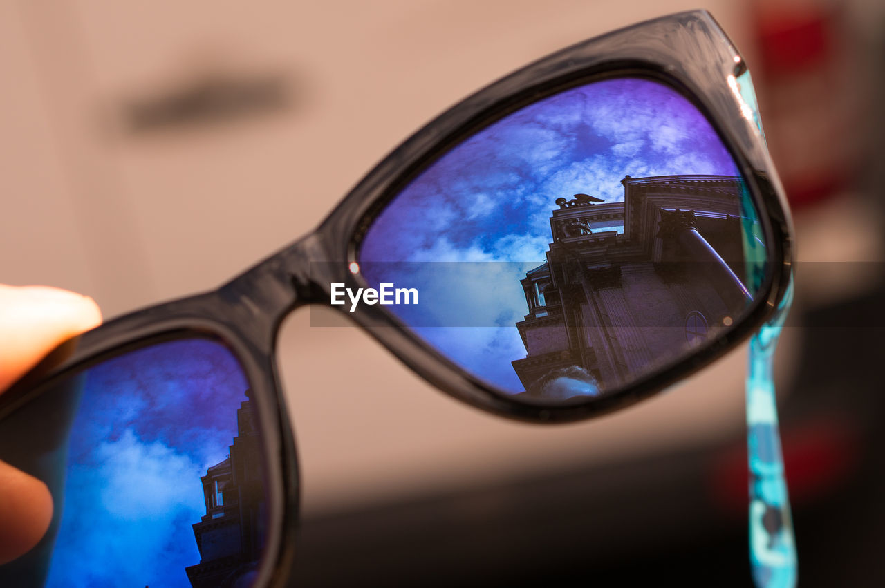 Reflection of historic building on sunglasses